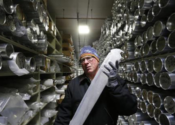 Geoffrey Hargreaves, curator of the National Ice Core Laboratory, carries an arctic ice core inside the minus-33 degree Fahrenheit environment of the lab's archive warehouse, in Lakewood, Colo.