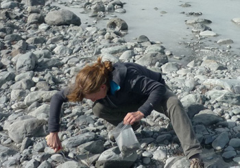 Bess Koffman samples fresh silt, called glacial flour, produced by the Tasman Glacier in New Zealand