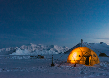 The researchers' ice drilling tent on the Eclipse Icefield, with Mt. Logan in the distant background