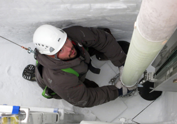 Lead driller Tanner Kuhl guides the Intermediate Depth Drill into position to start ice-coring operations