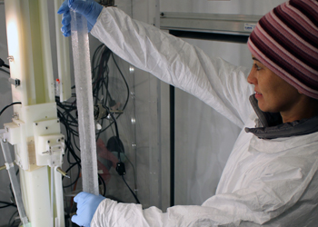 Monica Arienzo, Ph.D., an assistant research professor of hydrology at DRI, loads an 18,000-year-old sample of the WAIS Divide ice core for continuous chemical analysis