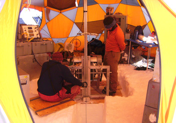 Mike Waszkiewicz (L) and Brad Markle (R) inside the drill tent with the Eclipse Ice Drill