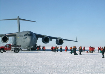 Passengers disembark from an Air Force C-17 Globemaster aircraft near McMurdo Station in the 2011 photo