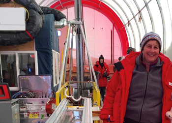 Julie Palais stands next to the IDD at South Pole, Antarctica