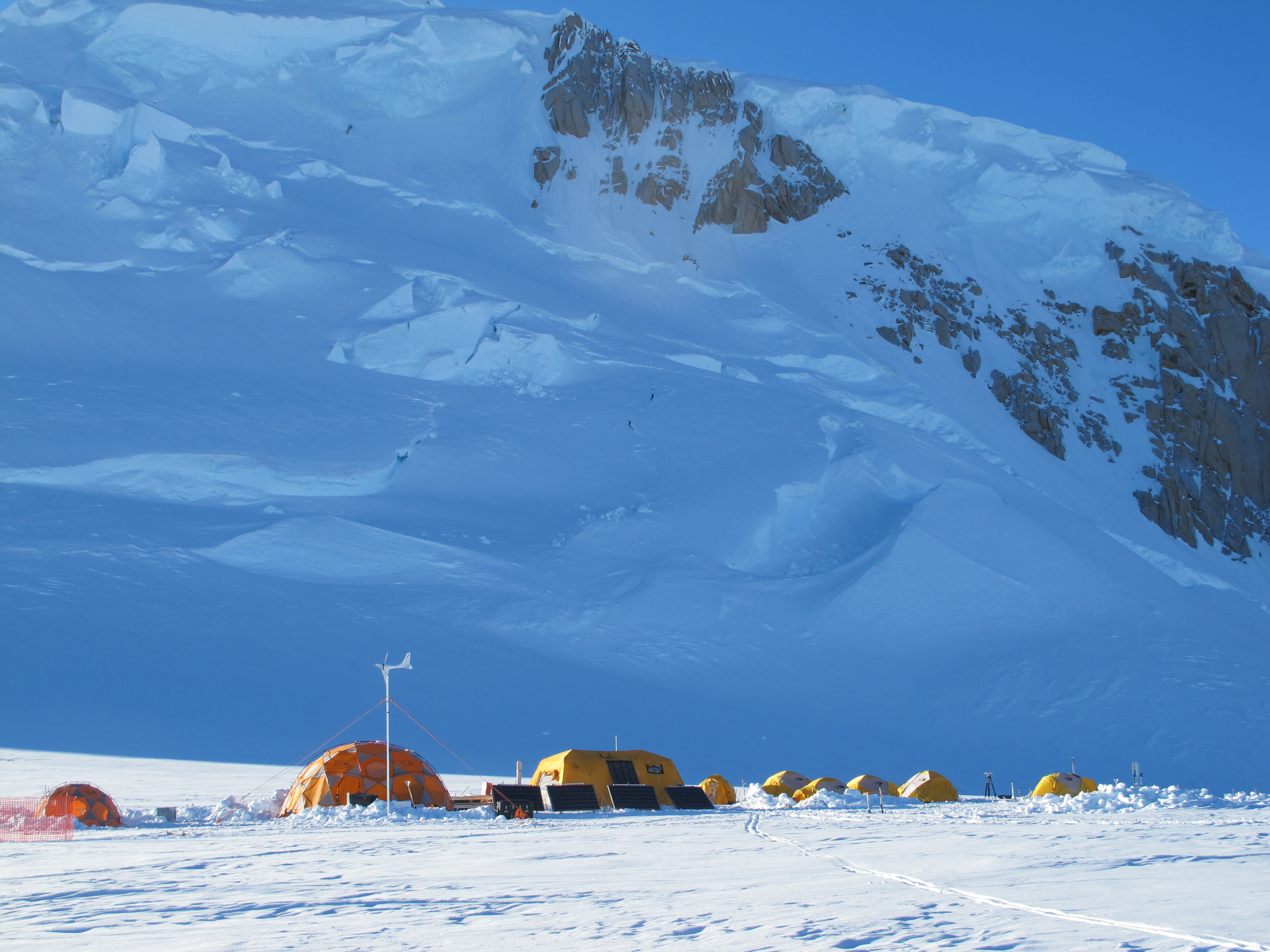 The ice-drilling field camp with Mt. Hunter in the background
