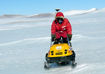 Leigh Sterns pulls an instrument behind a snowmobile to map the Allan Hills Blue Ice Area in 2004