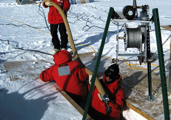 Murat Aydin and Todd Sowers prepare to sample firn air at South Pole