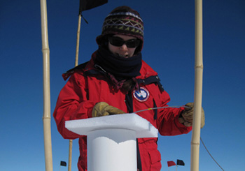 Anais Orsi adjusting the depth of the borehole thermometer at WAIS Divide, Antarctica.