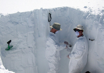 Eric Kelsey and Cameron Wake collect snowpit samples from the Upper Yetna Glacier