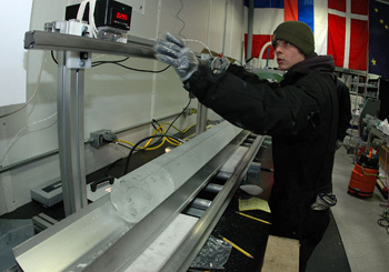 National Ice Core Lab intern Mick Sternberg measures the final section of ice core from the WAIS Divide project