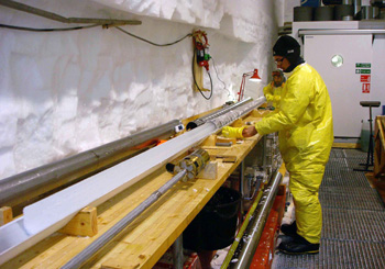 Pushing an ice core out of the drill