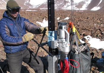 Tanner Kuhl drilling in the Dry Valleys, Antarctica