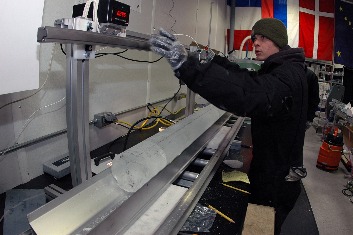 A NSF-ICF staff member measures a section of the WAIS Divide ice core as it begins its journey down a CPL