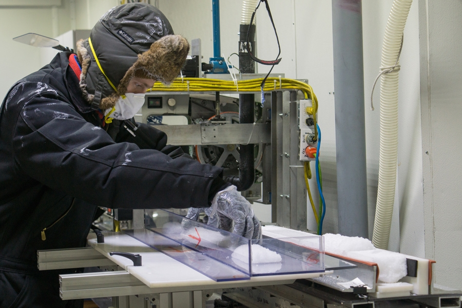 Richard Nunn, the assistant curator at the National Ice Core Laboratory, slices up recently acquired ice core samples