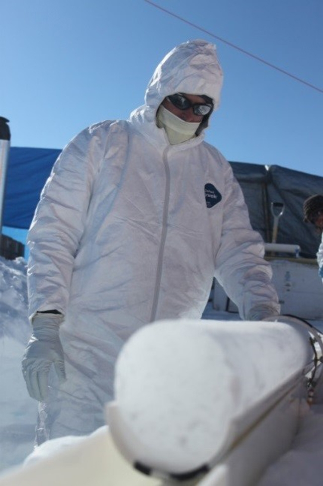 A scientist is measuring the electrical properties – a measure of the volcanic acidity content of the ice layers – in the field