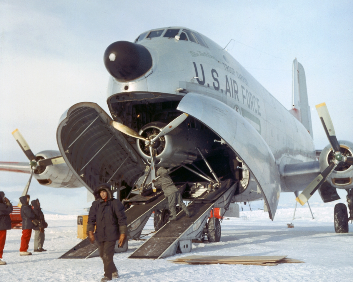 A U.S. Air Force C-124 Globemaster delivers an airplane to McMurdo Station, Antarctica, in 1956